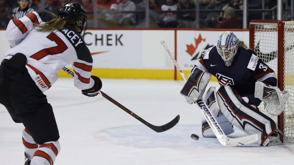 The United States goalie Alex Rigsby saves the shot by Canada's Laura Stacey