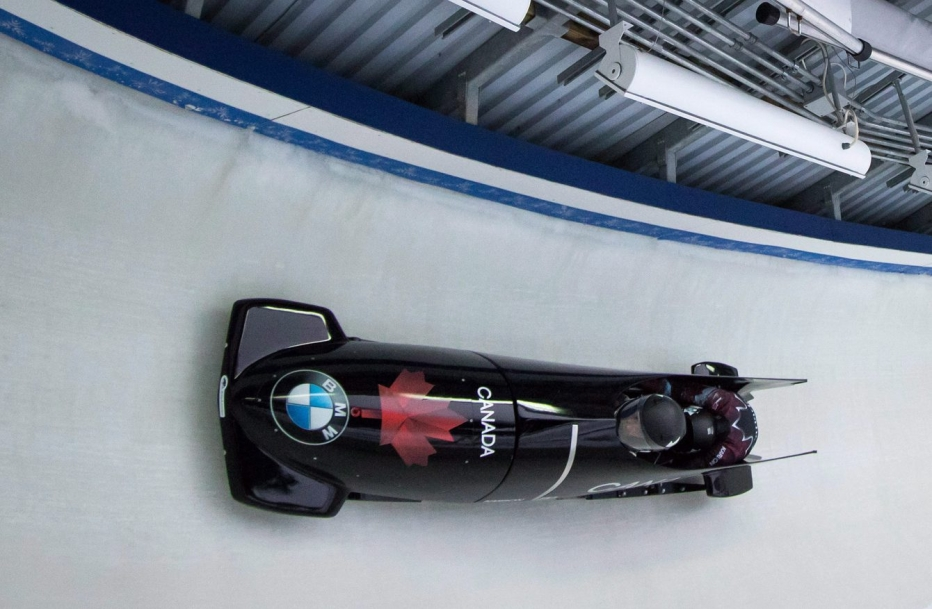 Alysia in a bobsleigh racing on the track