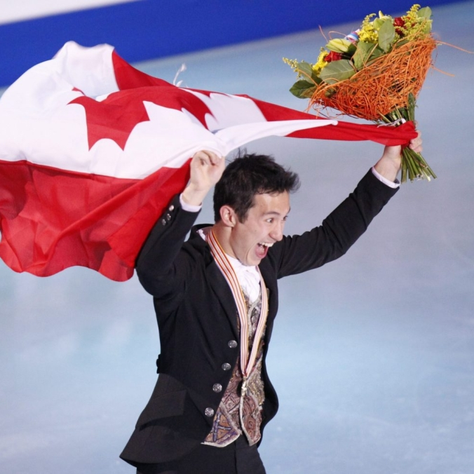 Patrick Chan skates with the national flag
