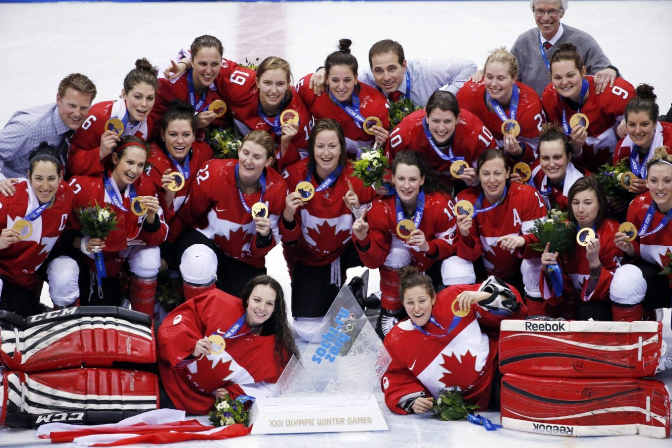 members of Team Canada pose for a photo with their gold medals