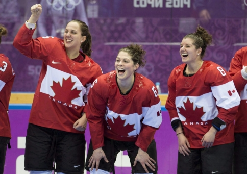 Lauriane Rougeau, Rebecca Johnston, and Laura Fortino, left to right, celebrate