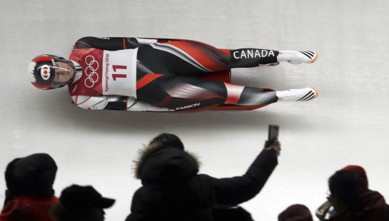 Alex Gough of Canada competes in her first run during the women's luge competition