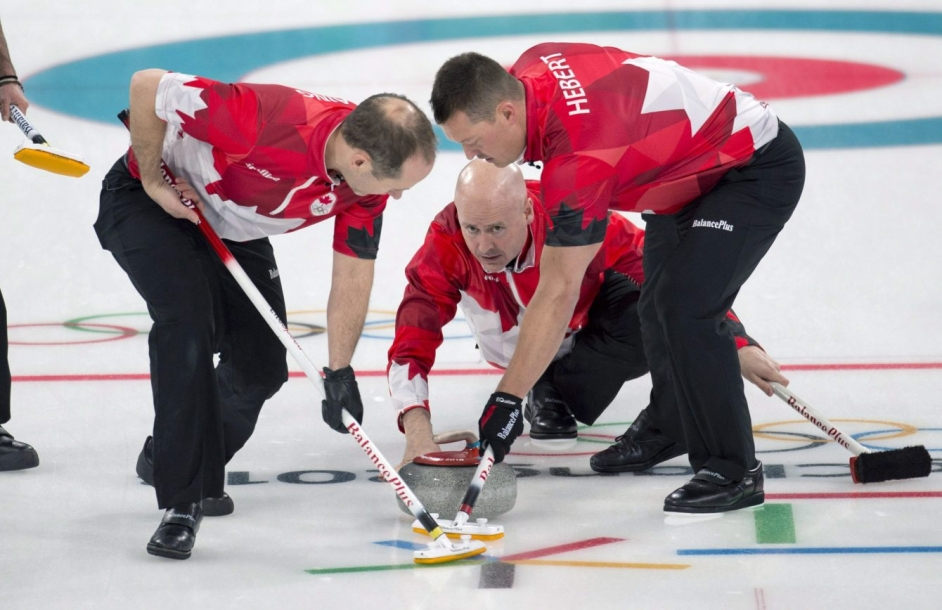 Canada skip Kevin Koe follows his front end of second Brent Laing