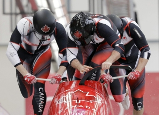 Driver Justin Kripps, Jesse Lumsden, Alexander Kopacz and Oluseyi Smith of Canada start their heat on the first day of four-man bobsled competition at the 2018 Winter Olympics in Pyeongchang, South Korea, Saturday, Feb. 24, 2018. (AP Photo/Wong Maye-E)