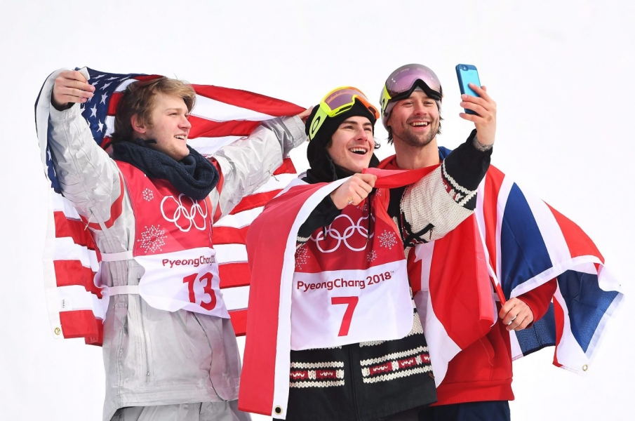Gold medallist Sebastien Toutant of Canada, centre, takes a selfie with silver medallist Kyle Mack of the United States, left, and bronze medallist Billy Morgan of Great Britain celebrate following the men's snowboard big air final at the 2018 Winter Olympic Games in Pyeongchang, South Korea, Saturday, Feb. 24, 2018. THE CANADIAN PRESS/Jonathan Hayward