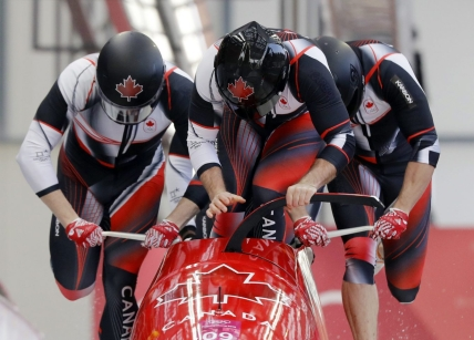 Driver Justin Kripps, Jesse Lumsden, Alexander Kopacz and Oluseyi Smith of Canada start their third heat during the four-man bobsled competition final at the 2018 Winter Olympics in Pyeongchang, South Korea, Sunday, Feb. 25, 2018. (AP Photo/Wong Maye-E)