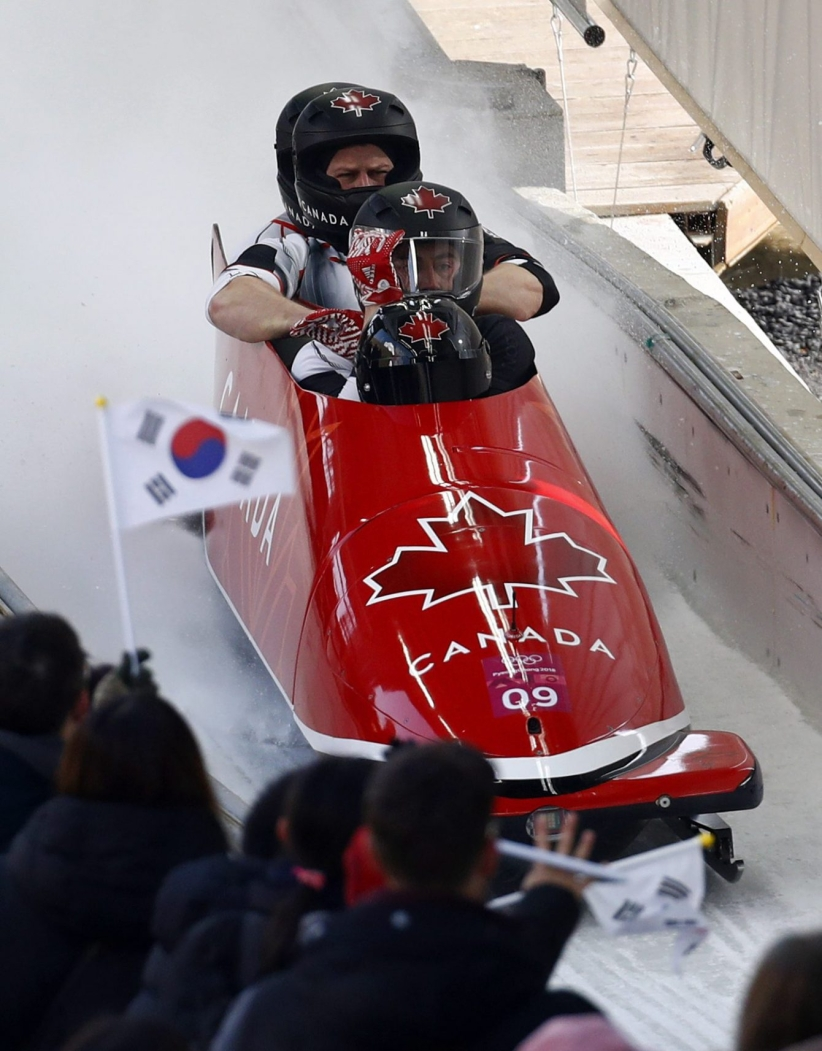 Driver Justin Kripps, Jesse Lumsden, Alexander Kopacz and Oluseyi Smith of Canada finish their third heat during the four-man bobsled competition final at the 2018 Winter Olympics in Pyeongchang, South Korea, Sunday, Feb. 25, 2018. (AP Photo/Patrick Semansky)