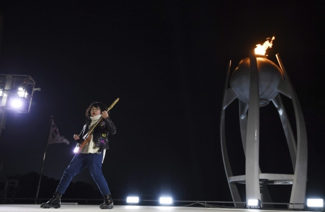 Thirteen-year-old guitarist Yang Tae-hwan plays a variation on 'Winter' from Vivaldi's The Four Seasons, during the closing ceremony of the 2018 Winter Olympics in Pyeongchang, South Korea, Sunday, Feb. 25, 2018. (Christof Stache/Pool Photo via AP)