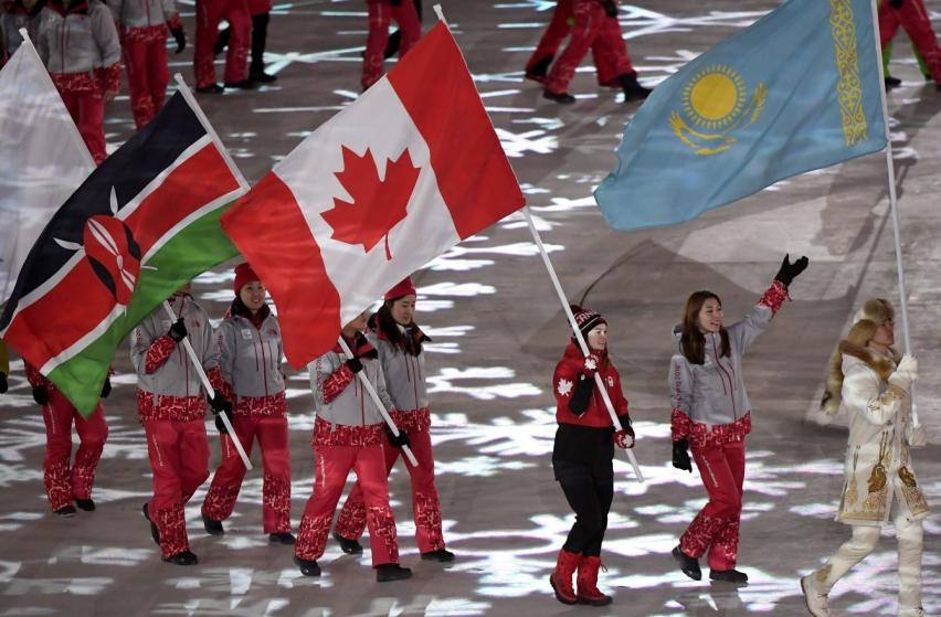 Canadian short-track speed skater Kim Boutin leads team Canada into the Olympic stadium carrying the Canadian flag during the closing ceremonies at the 2018 Pyeongchang Olympic Winter Games in Pyeongchang, South Korea, on Sunday, February 25, 2018. THE CANADIAN PRESS/Paul Chiasson