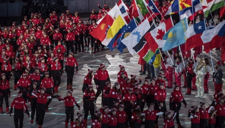 Canadian short-track speed skater Kim Boutin leads team Canada into the Olympic stadium Canadian athletes walk into the Olympic stadium during the closing ceremonies at the 2018 Pyeongchang Olympic Winter Games in Pyeongchang, South Korea, on Sunday, February 25, 2018. THE CANADIAN PRESS/Nathan Denettethe Canadian flag during the closing ceremonies at the 2018 Pyeongchang Olympic Winter Games in Pyeongchang, South Korea, on Sunday, February 25, 2018. THE CANADIAN PRESS/Nathan Denette