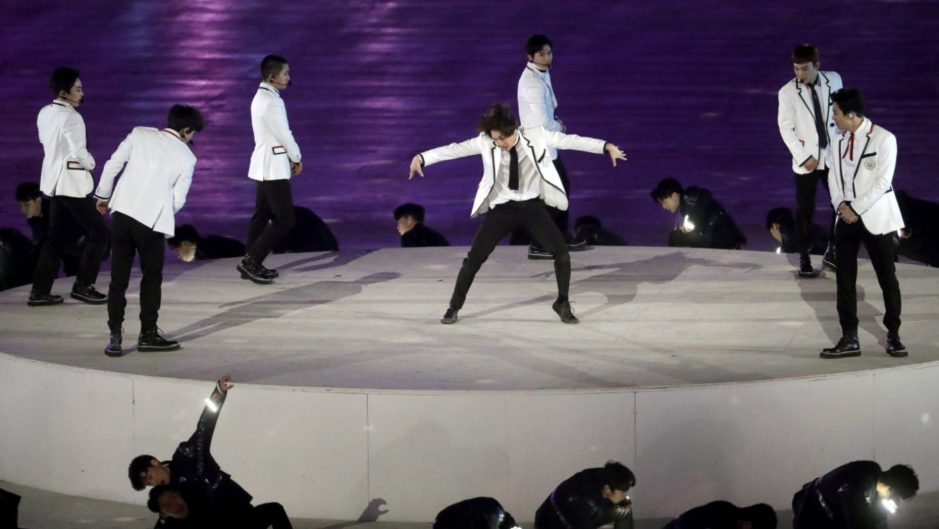 EXO performs during the closing ceremony of the 2018 Winter Olympics in Pyeongchang, South Korea, Sunday, Feb. 25, 2018. (AP Photo/Chris Carlson)
