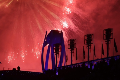Fireworks explode over the extinguished Olympic cauldron during the closing ceremony of the 2018 Winter Olympics in Pyeongchang, South Korea, Sunday, Feb. 25, 2018. (AP Photo/Michael Probst)