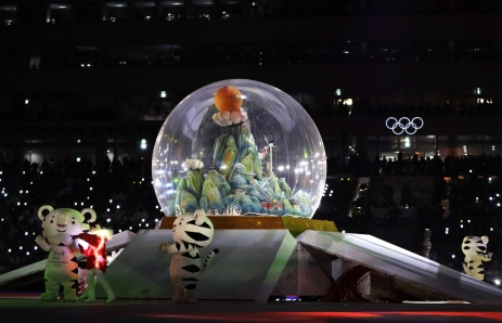 Olympic mascots stand by a snow globe during the closing ceremony of the 2018 Winter Olympics in Pyeongchang, South Korea, Sunday, Feb. 25, 2018. (AP Photo/Kirsty Wigglesworth)