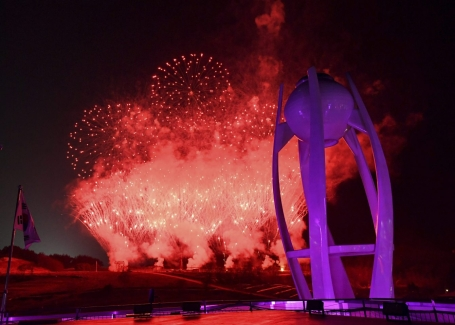 Fireworks explode near the Olympic cauldron at the end of the closing ceremony of the 2018 Winter Olympics in Pyeongchang, South Korea, Sunday, Feb. 25, 2018. (Florien Choblet/Pool Photo via AP)
