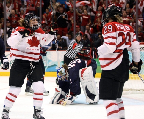 Meghan Agosta celebrates with Marie-Philip Poulin