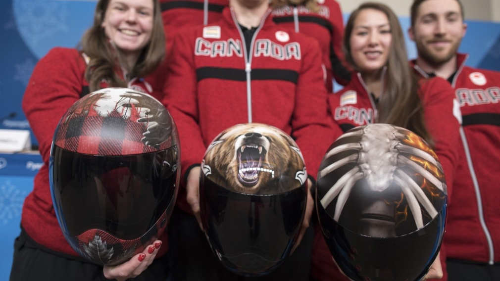What do Team Canada's skeleton racers have on their helmets?