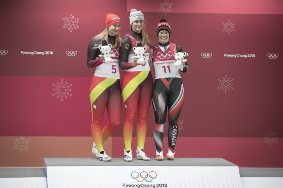 Team Canada's Alex Gough poses with Natalie Geinsenberger(L) and Dajan Eitberger(C) after winning Bronze