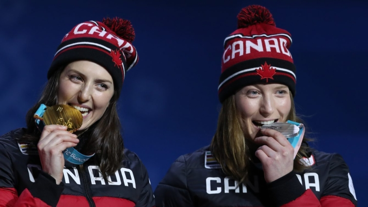Canada's Kelsey Serwa, left, and Brittany Phelan celebrate their gold and silver medals during a medal presentation ceremony at the PyeongChang 2018 Olympic Winter Games in Korea, Friday, February 23, 2018. THE CANADIAN PRESS/HO - COC Ð David Jackson