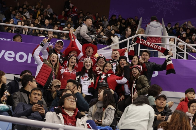Team Canada fans cheer on pairs figure skating at PyeongChang 2018.