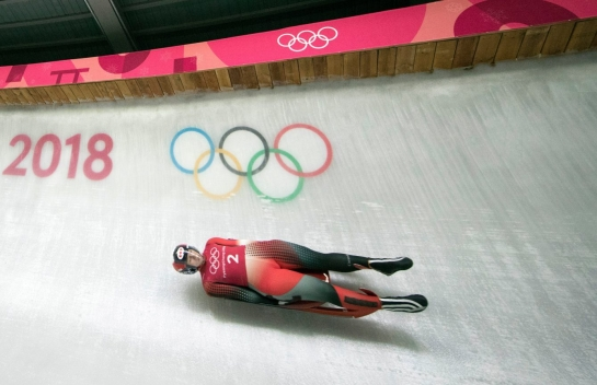 Alex Gough drives into turn fourteen during luge training runs