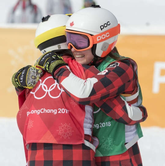 Canada's Kelsey Sherwa, red bib, celebrates with fellow Canadian Brittany Phelan after placing first and second in ski cross at the PyeongChang 2018 Olympic Winter Games in Korea, Friday, February 23, 2018. THE CANADIAN PRESS/HO - COC – Jason Ransom