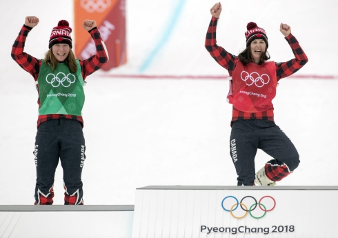 Canada's Kelsey Serwa, red bib, celebrates with fellow Canadian Brittany Phelan after placing first and second in ski cross at the PyeongChang 2018 Olympic Winter Games in Korea, Friday, February 23, 2018. THE CANADIAN PRESS/HO - COC – Jason Ransom