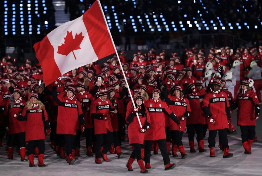 Tessa Virtue and Scott Moir lead Team Canada into the stadium during the Opening Ceremony of the Pyeonchang Winter Olympics in Pyeongchang, South Korea on February 9, 2018. Photo by Jason Ransom/COC