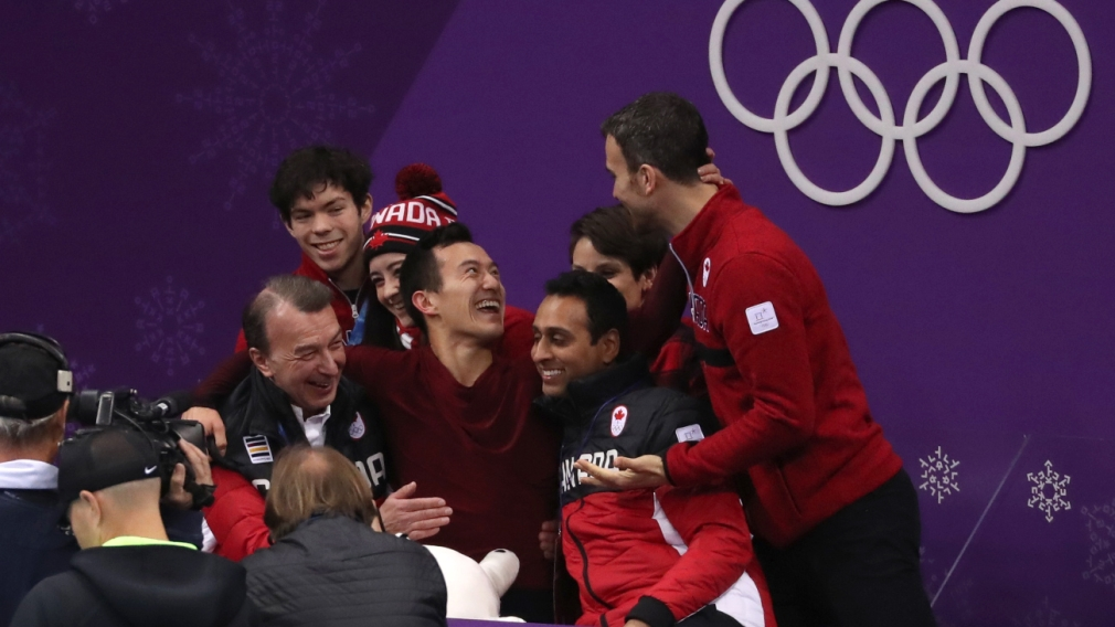 Patrick Chan performs his routine celebrates in the kiss and cry at PyeongChang 2018