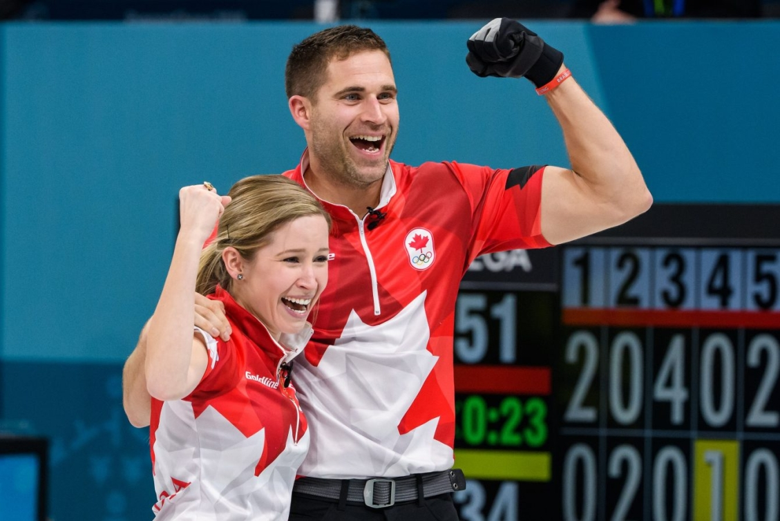 John Morris and Kaitlyn Lawes pump their fists in celebration