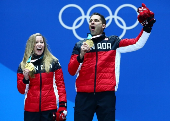 Kaitlyn Lawes and John Morris of Canada receive their Gold medal in Mixed Curling at the PyeongChang Olympic Plaza during the Pyeonchang Winter Olympics in Gangneung, South Korea on February 14, 2018. (Photo by Vaughn Ridley/COC)