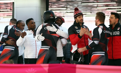 The Canadian teams congratulate each other following the 4-man Bobsleigh at the Olympic Sliding Centre during the PyeongChang 2018 Olympic Winter Games in PyeongChang, South Korea on February 25, 2018. (Photo by Vaughn Ridley/COC)