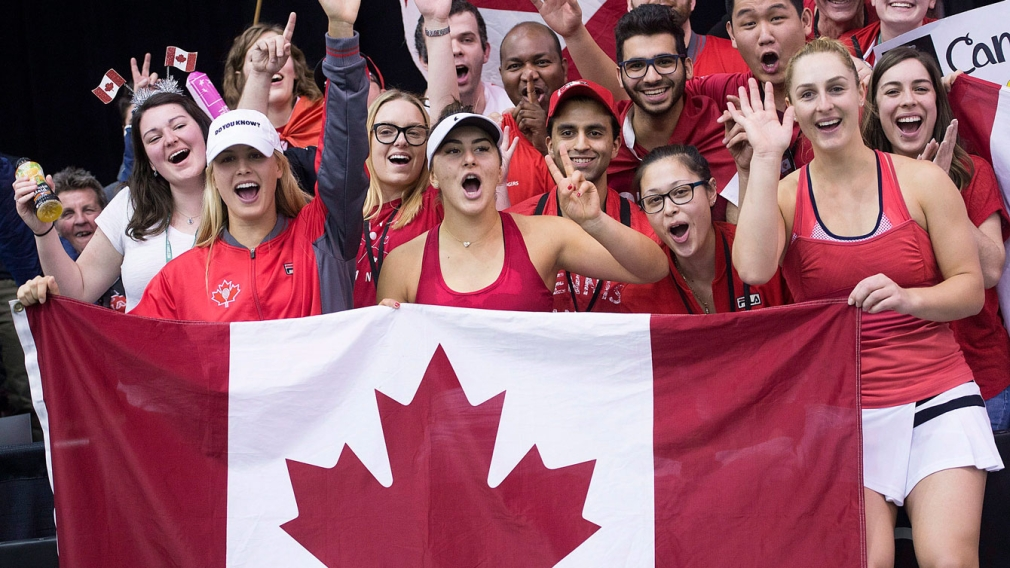 Genie Bouchard, Gaby Dabrowski and Bianca Andreescu celebrate after defeating Ukraine