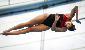 Pamela Ware mid air in dive