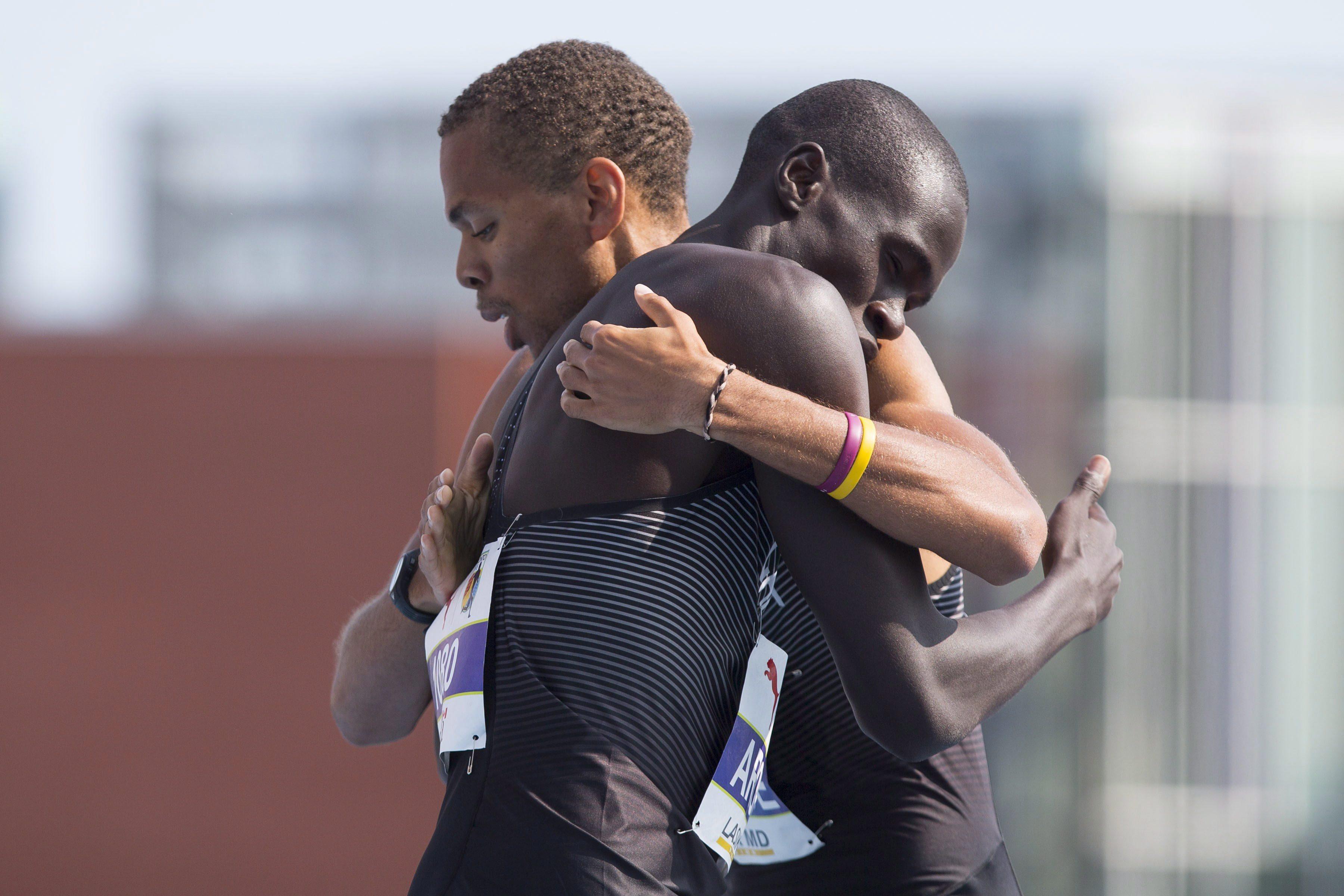 McBride embracing teammate Marco Arop