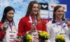 Ruck swims record time to defeat reigning Olympic champion