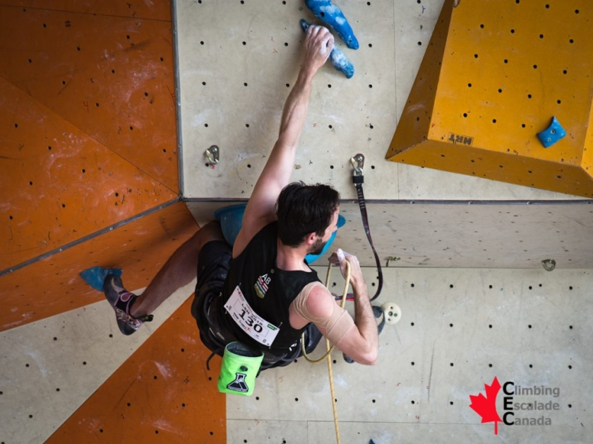 Jason Holowach competes in lead climbing