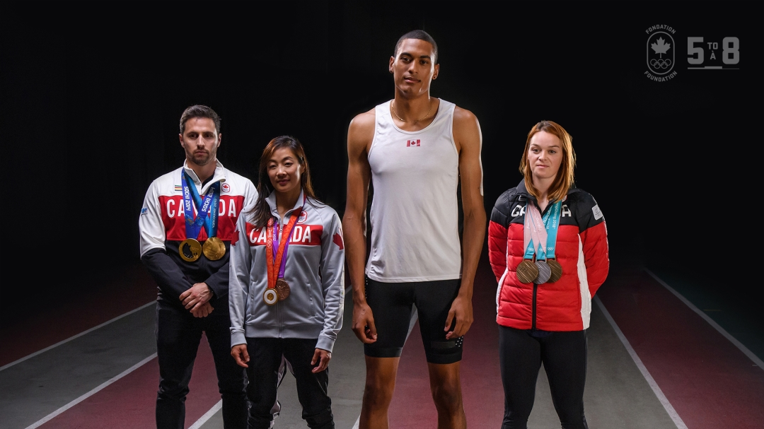 Olympians posing with their medals