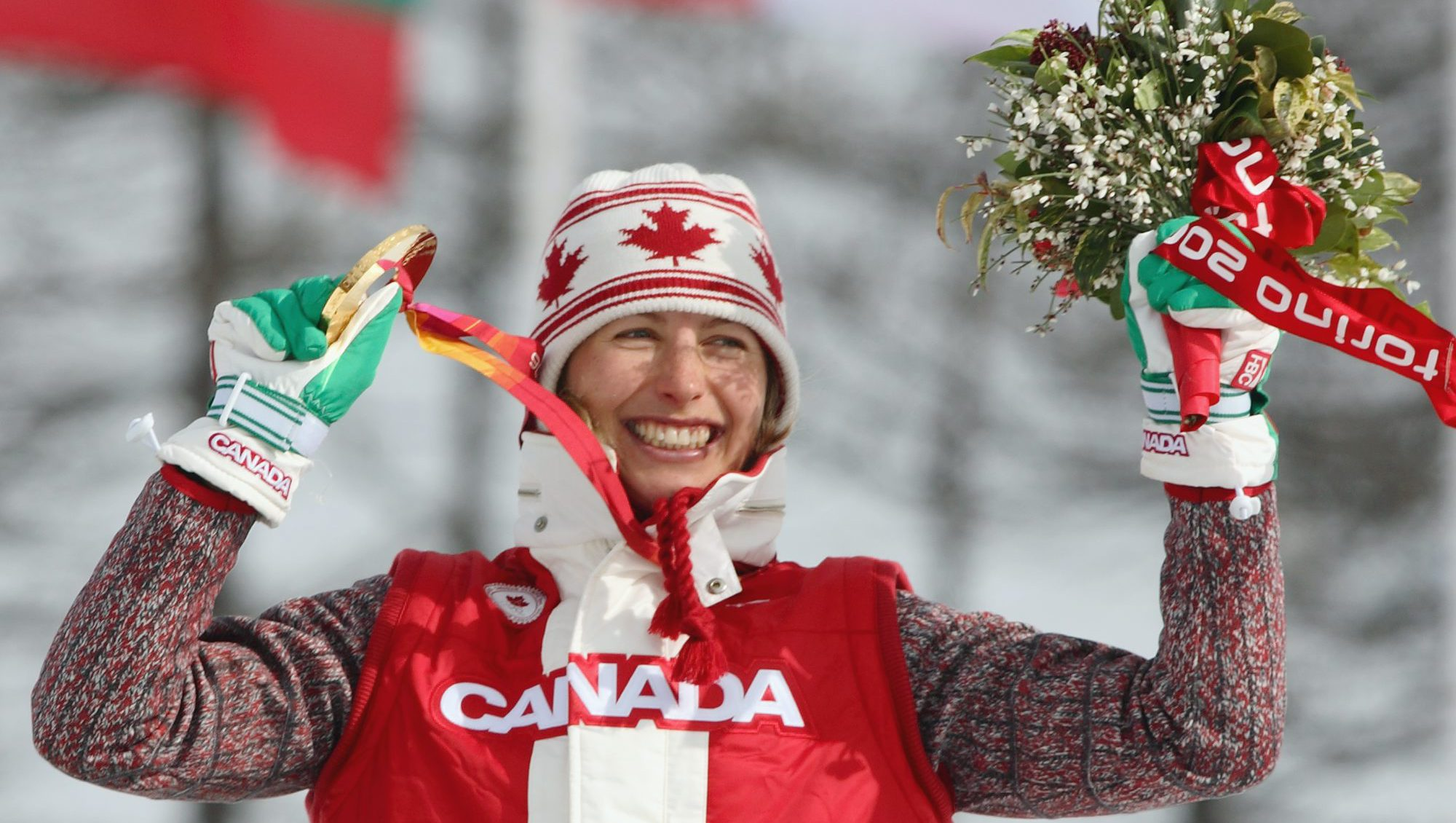 A Team Canada athlete poses with her medal