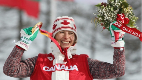 Chandra Crawford of Canmore, Alberta celebrates after winning the gold medal in the women's sprint cross country skiing race at the Olympic Games in Pragelato Plan, Italy on Tuesday February 22, 2006. (CP PHOTO/Frank Gunn)