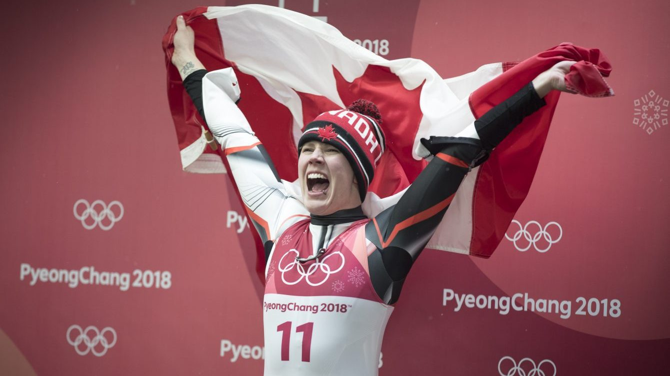 Gough cheering holding Canadian flag