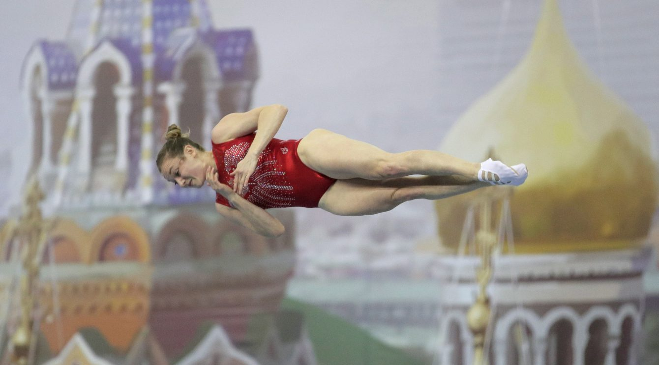 Rosie Maclennan horizontal & mid-air during a routine.