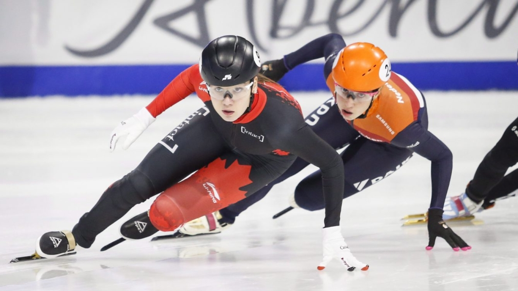 Short track speed skaters competing