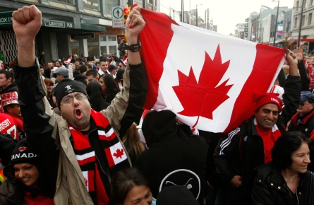 Canadian fans celebrate their gold medal victory against the United States in the final hockey match at the Vancouver 2010 Olympics, in downtown Vancouver, British Columbia, Sunday, Feb. 28, 2010. (AP Photo/Chris Carlson)