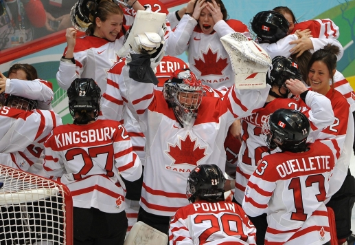 Canadian players celebrate after defeating the USA during the women's Olympic gold medal ice hockey game at the Vancouver 2010 Olympics in Vancouver, Thursday Feb. 25, 2010. THE CANADIAN PRESS/Scott Gardner