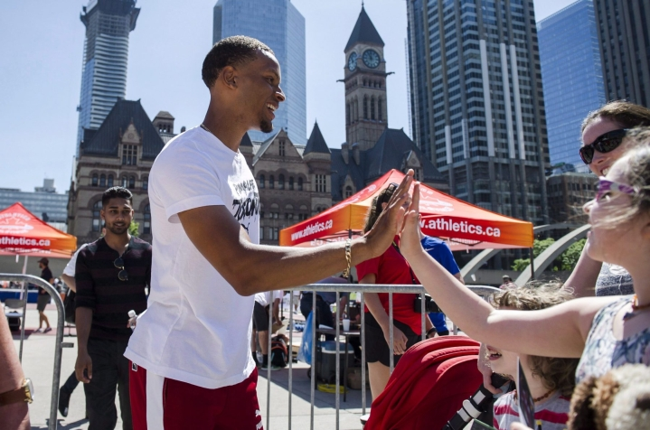 Olympic medalist Andre De Grasse greets fans during a street exhibition of track and field at Nathan Phillips Square in Toronto on Tuesday, June 12, 2018. THE CANADIAN PRESS/Christopher Katsarov