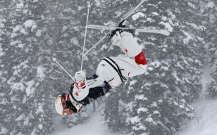 Mikael Kingsbury performs a jump in moguls