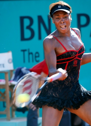 Venus Williams returns the ball