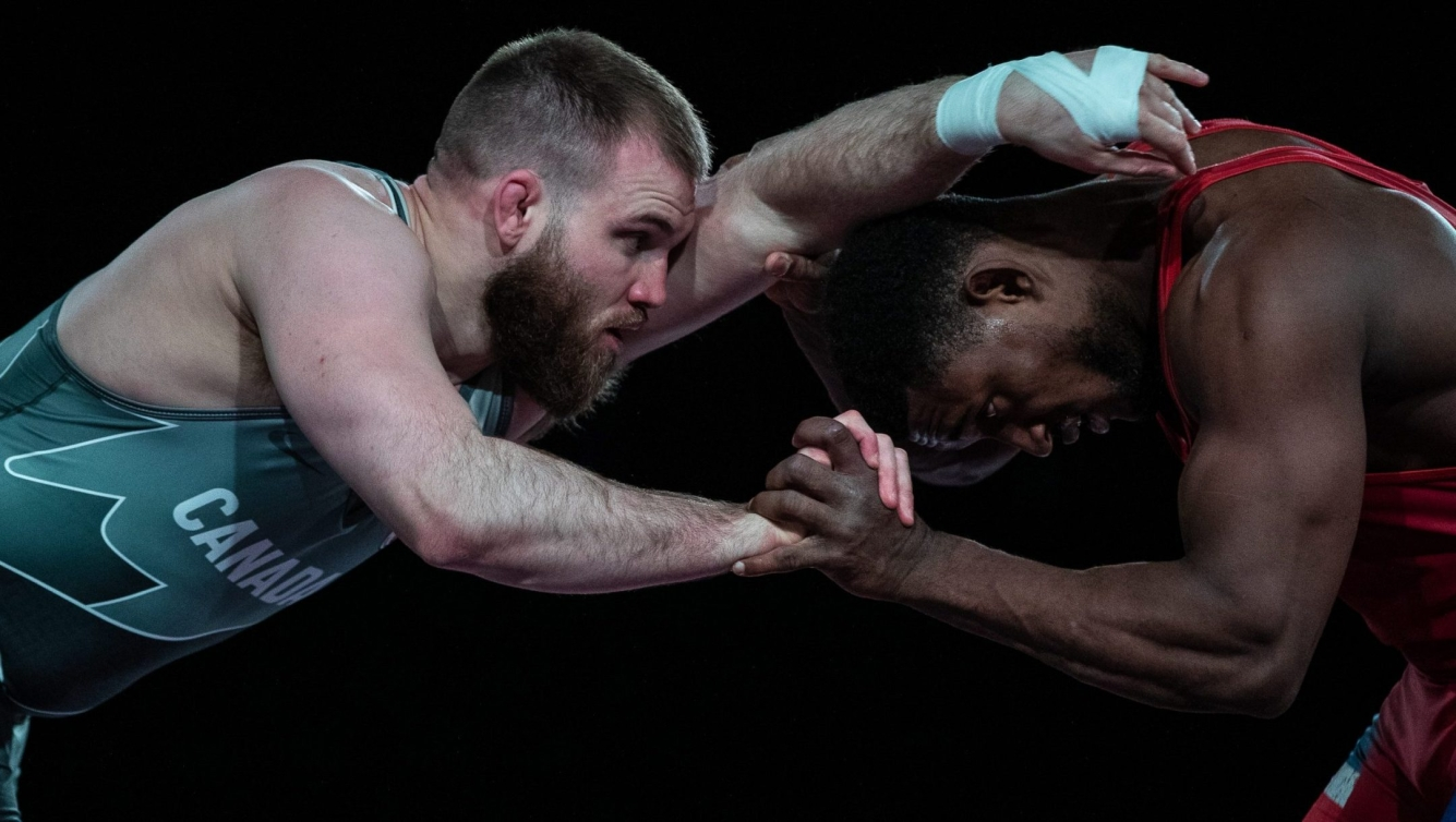 Two wrestlers in a hold