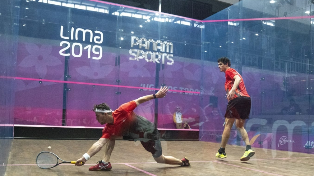 Two squash players competing