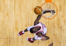 Overhead shot of Chris Boucher attempting to dunk the ball.